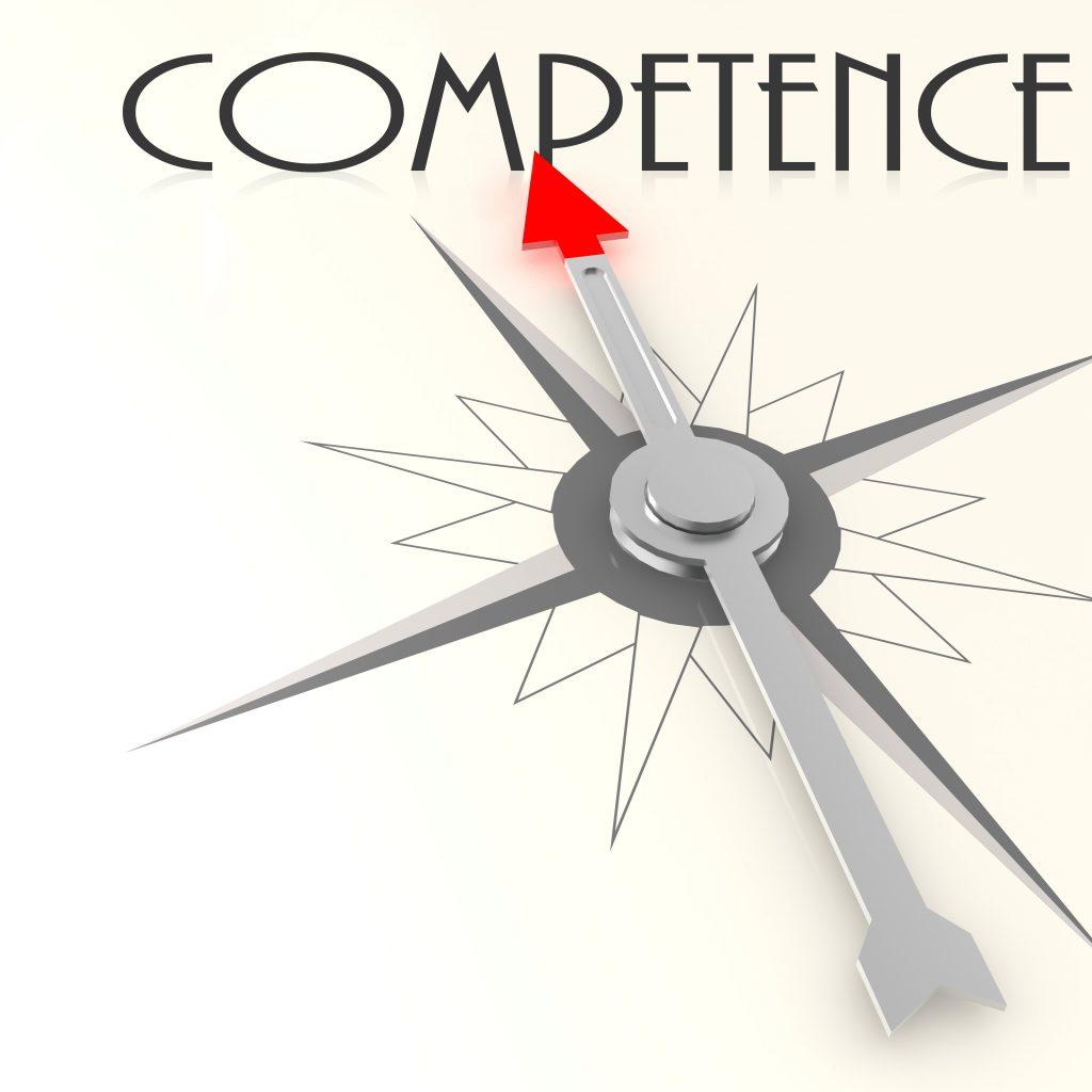 """Kompassnadel, die auf das Wort """"competence"""" zeigt"""